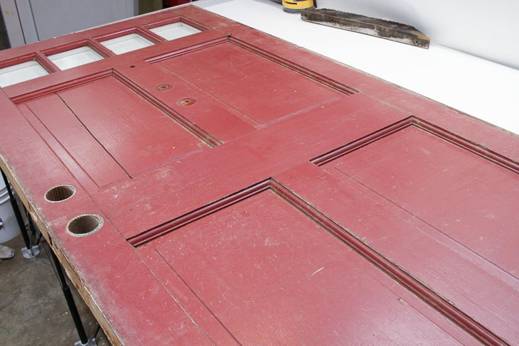 burgundy side of dumpster found door