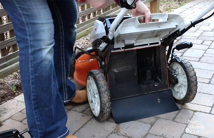 lifting back hatch on mower