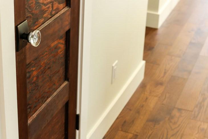 Reclaimed wood door with round glass door knob