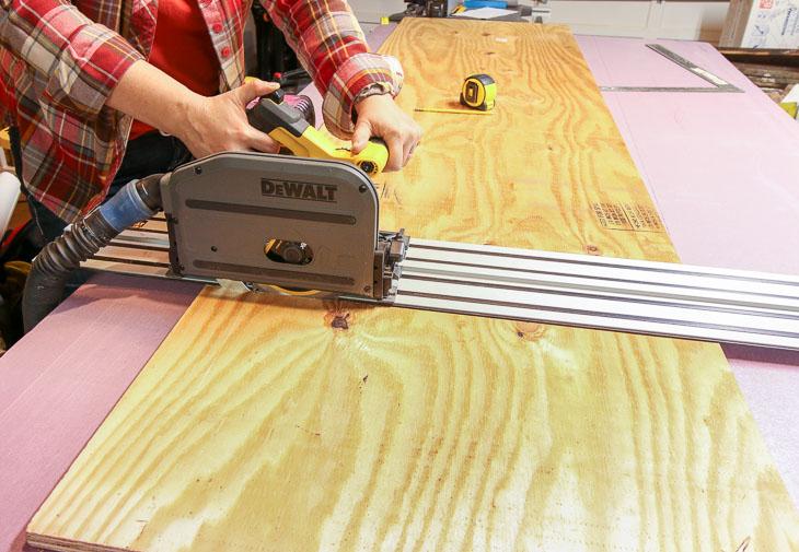 using DeWalt battery-powered track saw to cut plywood