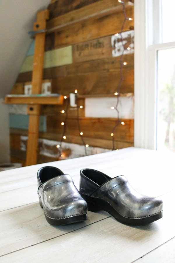 silver clogs on table