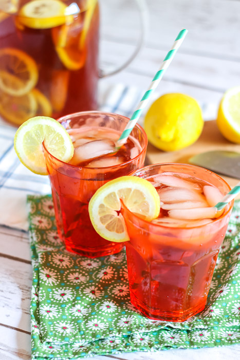 Sun tea in glasses topped with lemon slices