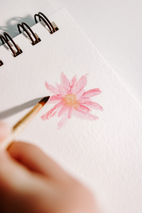 painting a watercolor petal on a daisy flower