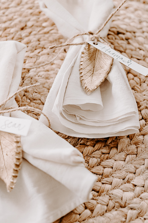 napkins tied with jute twine and clay leaves with names