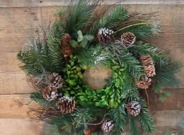 added boxwood wreath inside thrift store wreath
