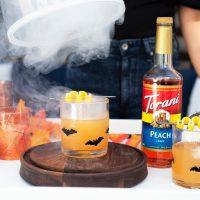 A Smoky Hallows Eve: Cocktail Recipe featuring Torani Peach Syrup