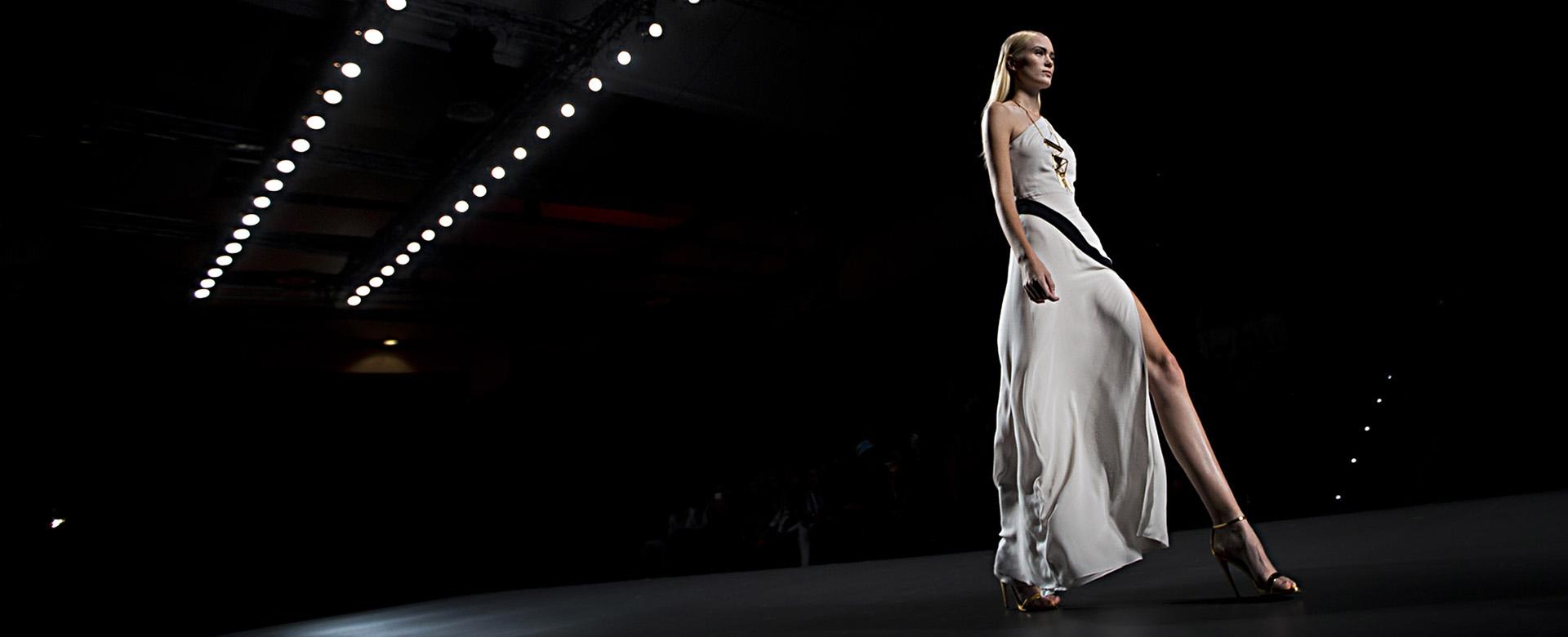 A model displays a Spring/Summer design by Ana Locking during Madrid's Fashion Week, in Madrid, Spain, Friday, Sept. 13, 2013 . (AP Photo/Daniel Ochoa de Olza)