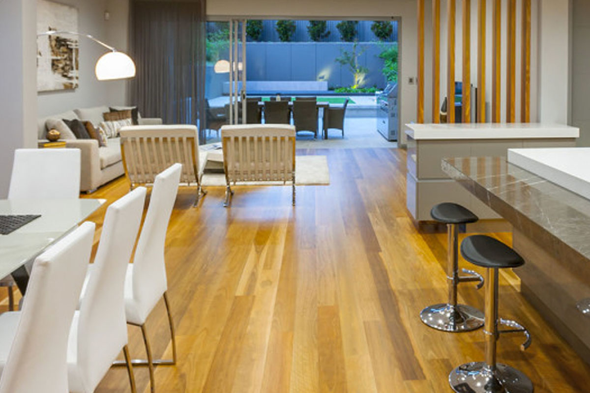 Prima Designer Homes Como Display Home featuring dining and living areas overlooking private gardens. Featuring solid timber floors and full frame floor to ceiling windows.