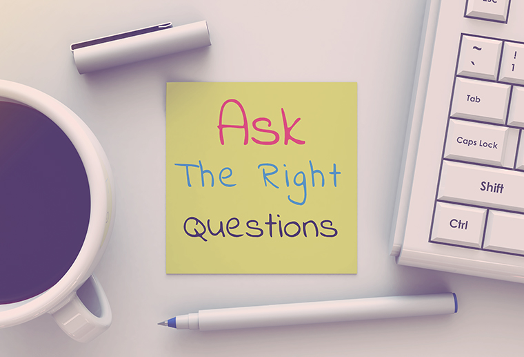 Ask The Right Questions, message on note paper, computer and cof
