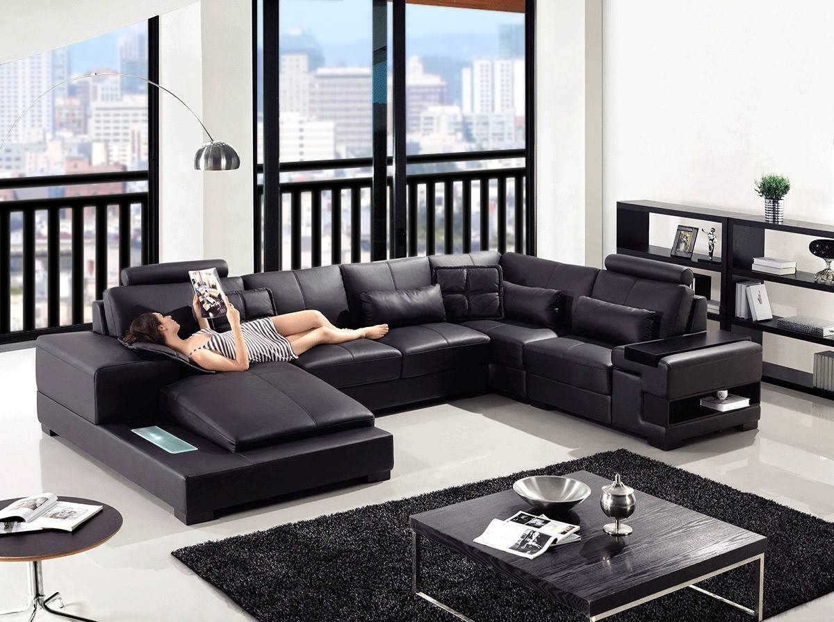 elite curved sectional sofa in leather with pillows
