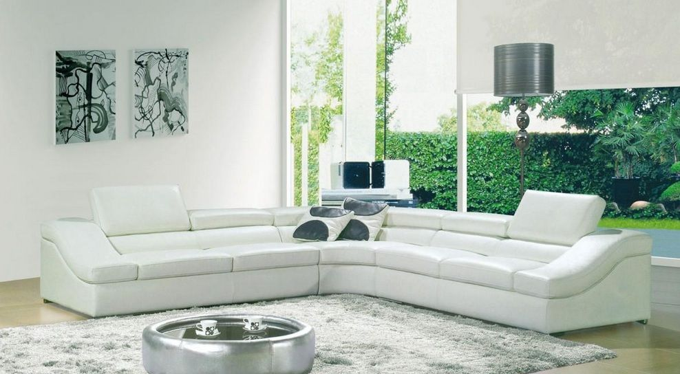 contemporary white sectional sofa upholstered in bonded leather
