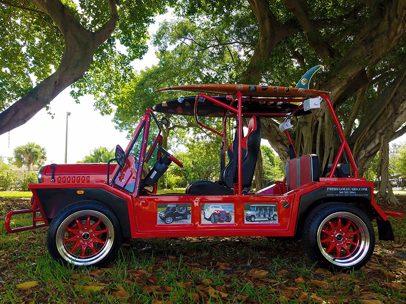 red moke golf car with custom beach package