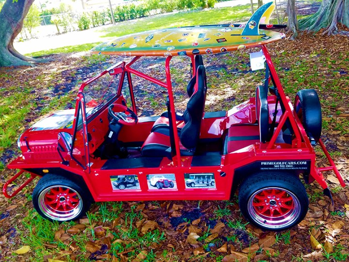 red moke with surfboards and custom sound system