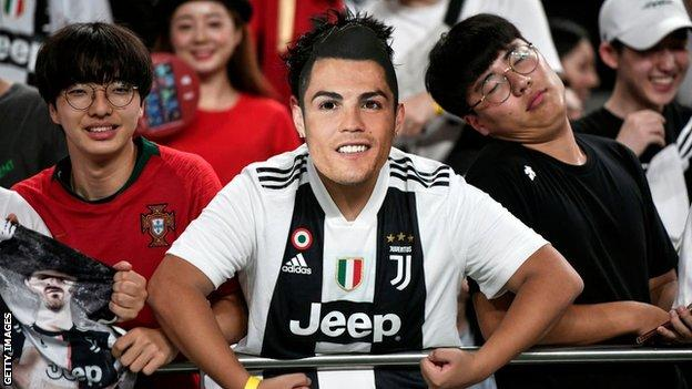 Fans in the crowd in Seoul dressed up as Ronaldo
