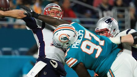 MIAMI GARDENS, FL - DECEMBER 11:   Jordan Phillips #97 of the Miami Dolphins blocks a pass attempt by  Tom Brady #12 of the New England Patriots in the fourth quarter at Hard Rock Stadium on December 11, 2017 in Miami Gardens, Florida.  (Photo by Mike Ehrmann/Getty Images)