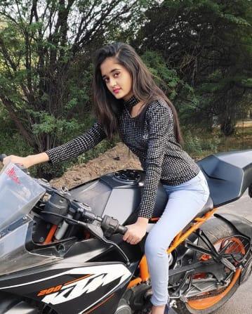 Kavya Yadav With Her Bike