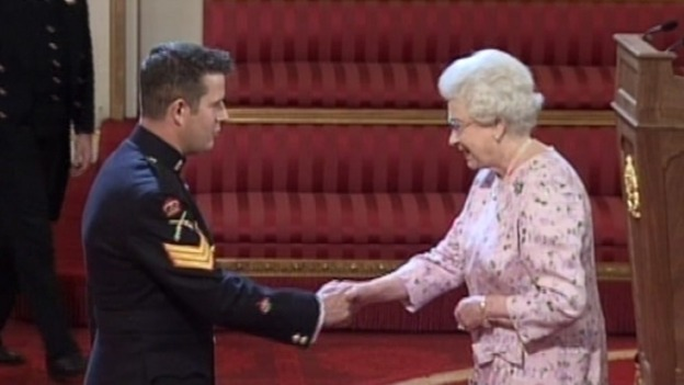 WO1 K Hughes receiving his George Cross from Her Majesty