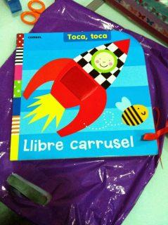libro carrusel toca toca combel