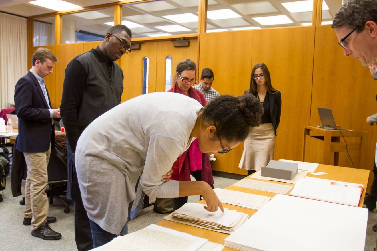Playwrights examining archival documents