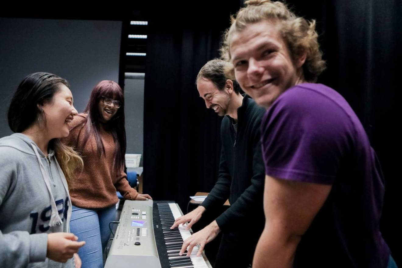 Students rehearsing at keyboard