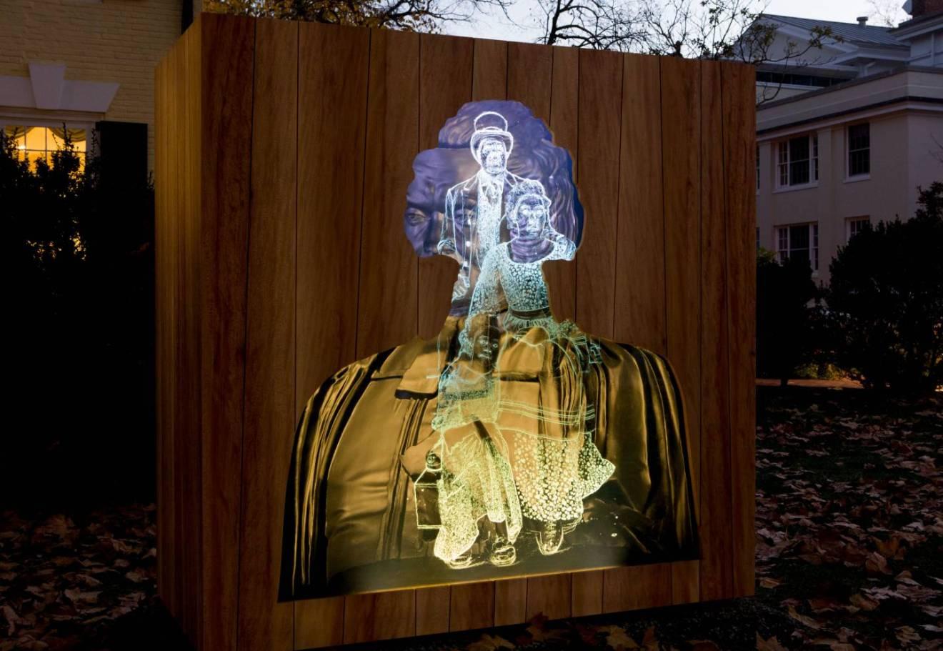 Titus Kaphar's sculpture lit up at night