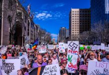 """Women's March Austin-1"" by Lauren Harnett liscensed under CC BY 2.0 (via Flickr)"