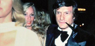 An old snapshot of Hugh Hefner smoking a pipe.