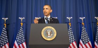 A photo of Barack Obama speaking behind a podium.