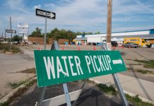 """Photograph of """"Water Pickup"""" sign in Flint, Michigan"""