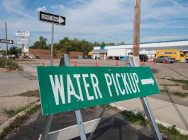 "Photograph of ""Water Pickup"" sign in Flint, Michigan"