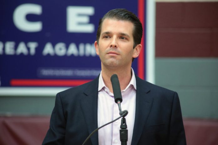 portrait of Donald Trump Jr. at a campaign event