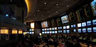 Image of gamblers in a sports betting hall.