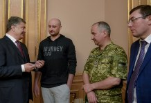 Image of Arkady Babchenko speaking with politicians.