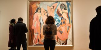 """Silhouettes of people in front of Picasso's painting """"Les Demoiselles d'Avignon"""""""