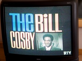 """Photograph of an older TV with """"The Bill Cosby"""" displayed on it"""
