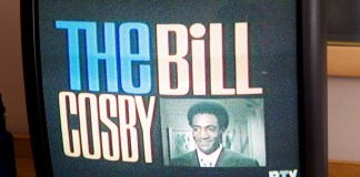"Photograph of an older TV with ""The Bill Cosby"" displayed on it"