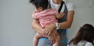 Image of a woman holding a young child