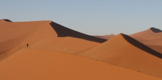 Namibian sand dunes outlined against blue sky
