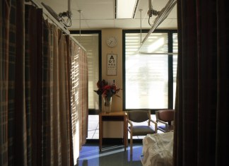 photograph of empty hospital room with flowers
