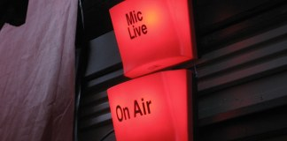 "photograph of lit ""Mic Live"" and ""On Air"" signals"
