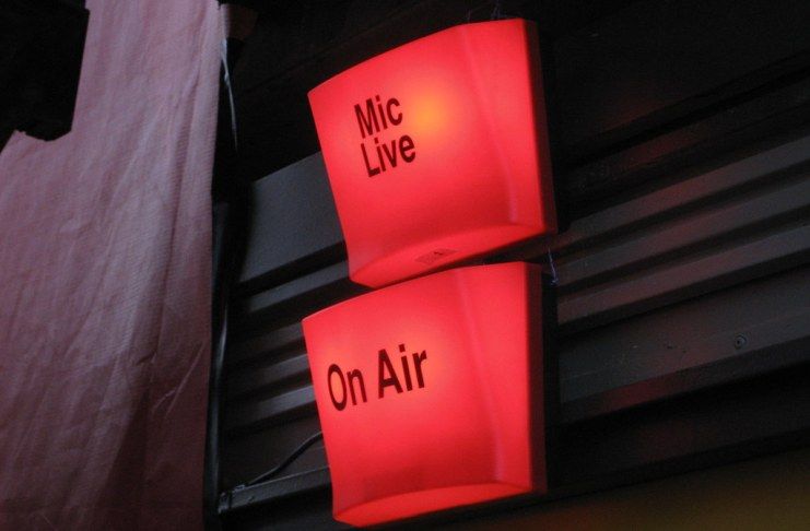 """photograph of lit """"Mic Live"""" and """"On Air"""" signals"""