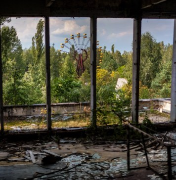 Photograph of Pripyat ferris wheel from inside abandoned building