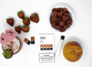 photograph of Juul pods with strawberries, raspberries, a peach, and a cocktail