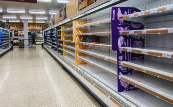 photograph of empty shelves at a grocery store