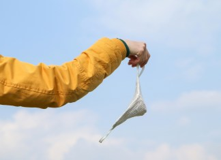 photograph of someone casting off face mask