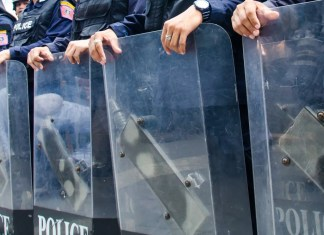 photograph of police line with riot shields