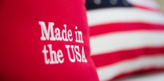 """photograph of """"Made in the USA"""" embroidered pillow will US flag pillow in background"""
