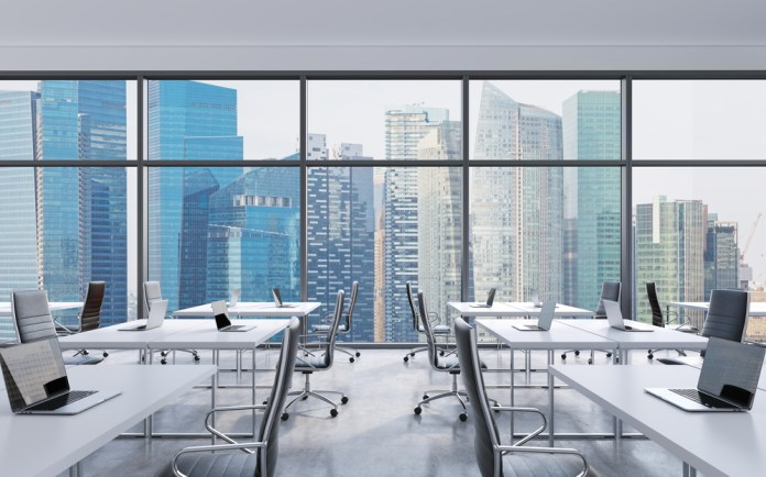 photograph of an empty office looking out over city