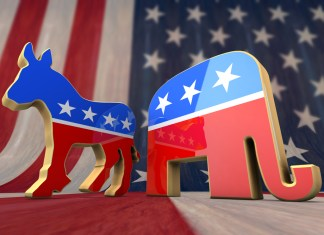 photograph of democratic and republican party figurines atop the American flag