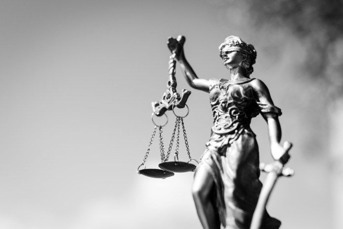 black-and-white photograph of lady justice